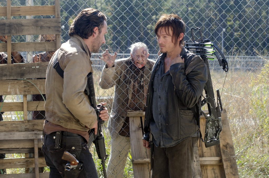 Rick Grimes (Andrew Lincoln), Daryl Dixon (Norman Reedus) and Walkers - The Walking Dead - Season 3, Episode 15 - Photo Credit: Gene Page/AMC